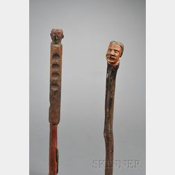 Two Carved and Painted Walking Sticks with Head Finials