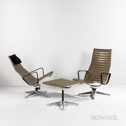 Two Eames Aluminum Group Lounge Chairs and an Ottoman