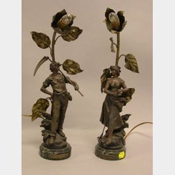 Pair of Art Nouveau Patinated Metal Figural Faneuse and Faucheur Table Lamps.
