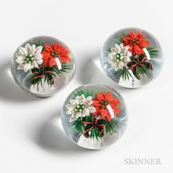 Three Ken Rosenfeld Red and White Poinsettia Paperweights