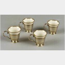 Set of Twelve Porcelain and Sterling Framed Demitasse Cups and Saucers