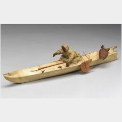 Inuit Hide and Wood Kayak with Paddler