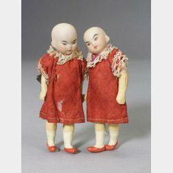 Pair of Small Oriental Bisque Head Dolls