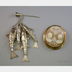 Chinese Silver Fish Stickpin and a 9kt Gold Framed Shell Carved Cameo Brooch
