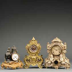 Three Metal Cased Clocks