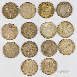 Eight Circulated Morgan Dollars and Six Peace Dollars.     Estimate $200-300