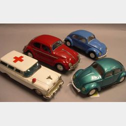 Two Tonka Painted Pressed Metal Volkswagen Beetles, a Painted Pressed Metal Battery Powered Volkswagen Beetle, and a Japanese Painted P