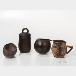 Four Rwandan Carved Wood Vessels