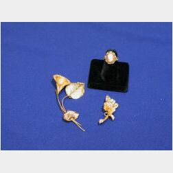 Two Gold Floral Brooches with Pearl Accents and a Cameo Ring.