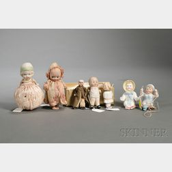 Four Small All-Bisque Dolls and Three Small Bisque Figures