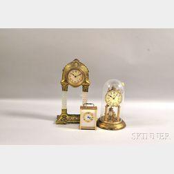 Three Brass-finished Clocks