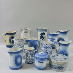 Eleven Blue and White Stoneware Jugs and Two Covered Jars