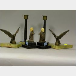 Two Pairs of Art Deco Bookends and a Pair of Brass Mounted Bakelite Candlesticks