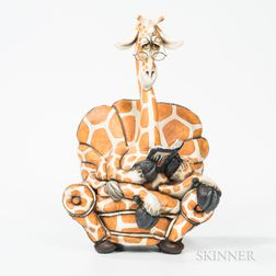 Todd Warner (American, b. 1945) Ceramic Giraffe Reading a Book in a Chair