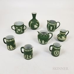 Eight Wedgwood Olive Green Vessels