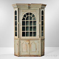 Carved, Painted, and Glazed Barrel-back Pine Corner Cupboard