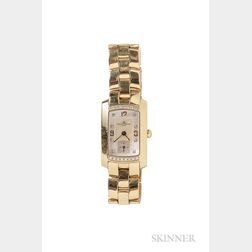 Lady's 18kt Gold and Diamond Wristwatch, Baume & Mercier
