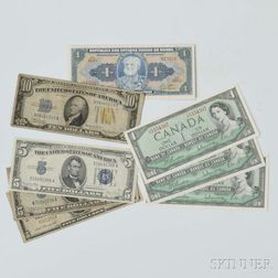 Three U.S. $5 Notes and a $10 Note