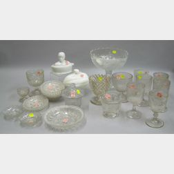 Twenty-seven Pieces of Mostly Colorless Pressed Glass Tableware