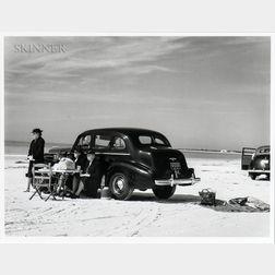 Marion Post Wolcott (American, 1910-1990)      Winter Visitors Picnicking on Running Board of Car on Beach, Sarasota, Florida