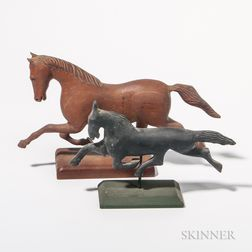 Two Carved Trotting Horses