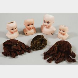Four German Bisque Doll Heads