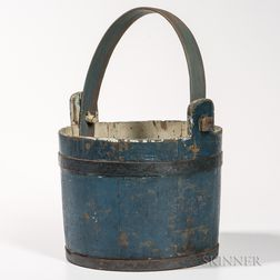 Blue-painted bucket
