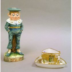 Kate Greenaway/Limoges Gilt Enamel Decorated Triangular Porcelain Cup and Saucer, and a Glazed Ceramic Palmer Cox Brownie Sailor Figu