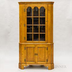 Eldred Wheeler Glazed Tiger Maple Two-part Corner Cupboard