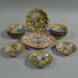 Fourteen Faience Platters and Saucers with Figural Scenes