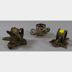 Three Late Victorian Silver Plated Figural Napkin Rings