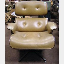 Eames-style Leather Upholstered Laminated Wood Swivel Lounge Chair.