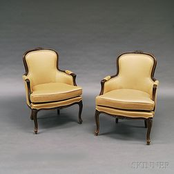 Pair of French Provincial-style Carved Fruitwood Bergeres