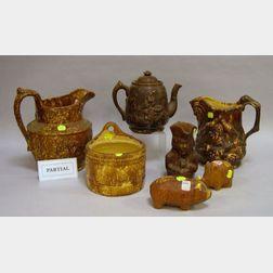 Two Rockingham Glazed Molded Stoneware Pitchers and Five Assorted Rockingham Glazed   Items