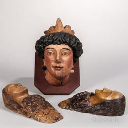 Three Carved and Painted Women's Head Plaques