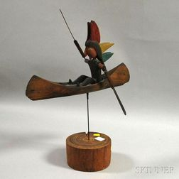 Carved and Painted Wood Figural Indian Paddling a Canoe Whirligig