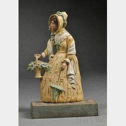 Polychrome-painted Cast Iron Lady with Basket of Flowers Doorstop