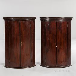 Pair of George III Mahogany and Mahogany-veneered Hanging Bow-front Corner Cabinets