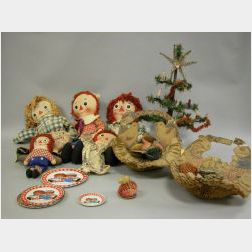 Two Easter Fold-up Decorations, a Miniature Christmas Tree, Five Raggedy Ann Dolls and Tin Plates.