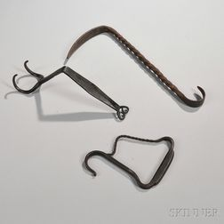 Three Wrought Iron Pot Lifters