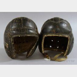 Two Vintage Black Painted Leather Football Helmets