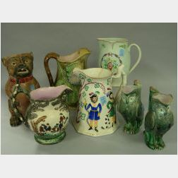Four Majolica Jugs and Four Assorted English Ceramic Jugs