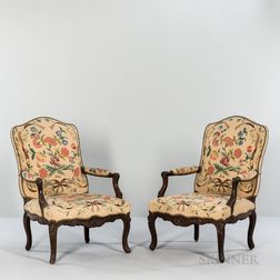 Pair of Louis XV Needlepoint-upholstered Walnut Fauteuils