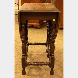 William & Mary Style Mahogany-finished Drop-leaf Gate-leg Table.
