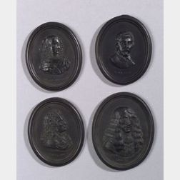 Four Wedgwood and Bentley Self Framed Black Basalt Portrait Medallions