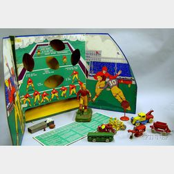 Seven Painted Cast Metal Vehicle Toys and Accessories and a Woolsey's Football Game