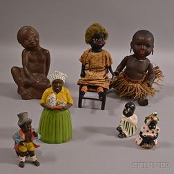 Seven Black Figures and Dolls