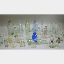 Forty-three Miscellaneous Aqua and Colorless Glass Bottles