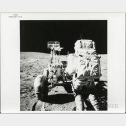Apollo 16, On Moon, John Young Reaches for Tools.