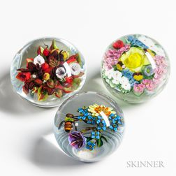 Three Floral Paperweights by Lundberg Studios, Ken Rosenfeld, and Melissa Ayotte